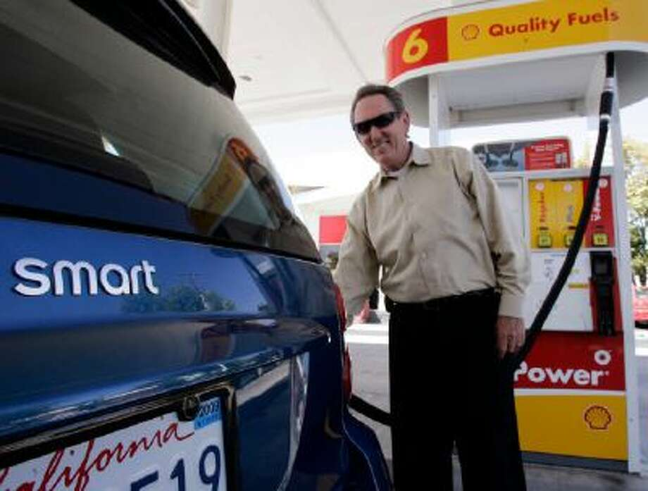 Shell customer Larry Syres fills up his Smart car in Palo Alto, Calif. Syres says he fills up his 8.7 gallon gas tank and that he averages 42 miles per gallon.