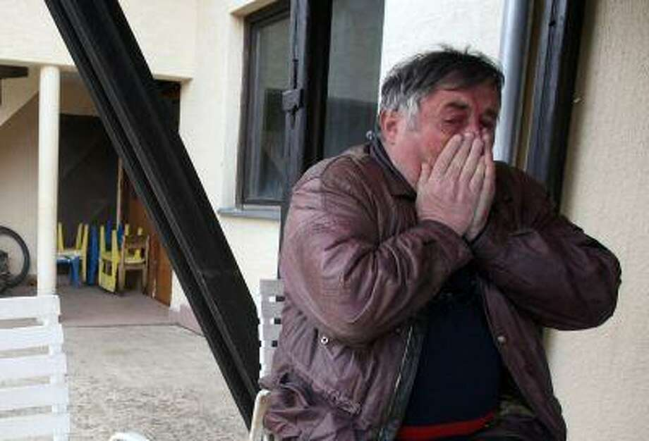 Radmilo Bogdanovic, brother of Ljubisa Bogdanovic cries in village of Velika Ivanca, Serbia, April 9. Ljubisa Bogdanovic a 60-year-old man gunned down 13 people, including a baby. Photo: ASSOCIATED PRESS / AP2013