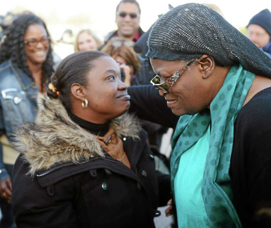 Bonnie Jean Foreshaw, right, embraces her granddaughter Chrisanne Guilbert, left, after answering questions from the media in a parking lot at Perez Park in East Lyme, Conn., Friday, Nov. 15 2013.  Foreshaw 66, spent 27 years in prison for the murder of a pregnant woman, was released on Friday, four years early, after state officials took the rare step of granting her clemency.  Foreshaw was sentenced to 45 years in prison for premeditated murder in the 1986 killing of a pregnant woman, Joyce Amos, in Hartford. The fetus didn't survive. Foreshaw argued she shot Amos by accident while defending herself against another person, a claim rejected by prosecutors.  Foreshaw is only the second inmate in a decade to have a clemency application approved by the Board of Pardons and Paroles.  (AP Photo/The Day, Sean D. Elliot)  MANDATORY CREDIT Photo: AP / The Day