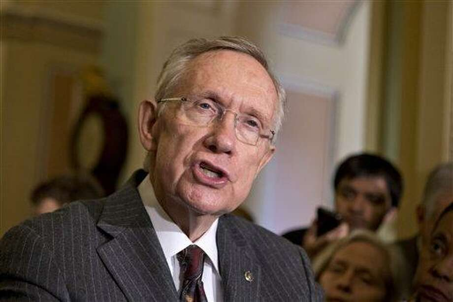 Senate Majority Leader Harry Reid, D-Nev., speaks with reporters following a Democratic strategy session at the Capitol in Washington, Tuesday, April 9, 2013. Reid said he plans showdown vote on gun control on Thursday. (AP Photo/J. Scott Applewhite) Photo: AP / AP
