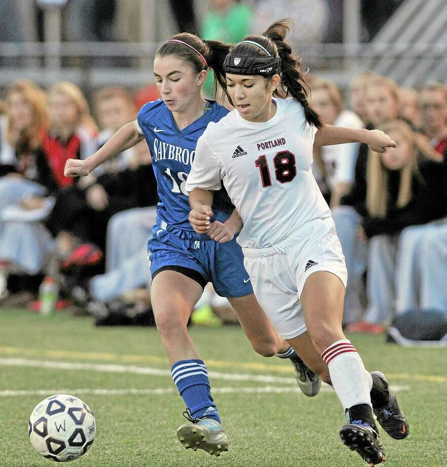Portland senior Jackie Otake dribbles past Old Saybrook freshman MaryKate Marshall in the CIAC Class S State Girls Soccer Championship game at Rosek-Skubel Stadium at Middletown High School Saturday evening. The game ended in a 0-0 tie after double overtime and both teams are declared co-champions. Photo: Catherine Avalone — The Middletown Press  / TheMiddletownPress