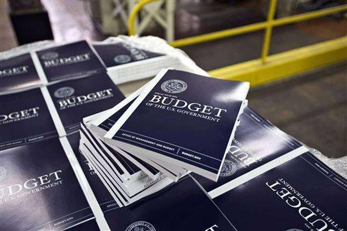 In this April 8, 2013, photo, copies of President Barack Obama's budget plan for fiscal year 2014 are prepared for delivery at the U.S. Government Printing Office in Washington. Obama is sending Congress on Wednesday, April 10, his long-awaited budget, an effort to achieve an elusive