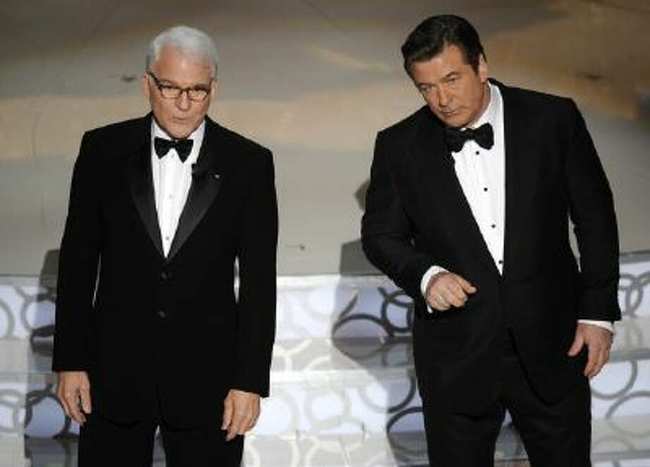 In this March 7, 2010 file photo, hosts Alec Baldwin, right, and Steve Martin are seen on stage at the 82nd Academy Awards, in the Hollywood section of Los Angeles. The Board of Governors of the Academy of Motion Picture Arts and Sciences will present Honorary Awards to Martin, Angela Lansbury, and Piero Tosi, and the Jean Hersholt Humanitarian Award to Angelina Jolie.