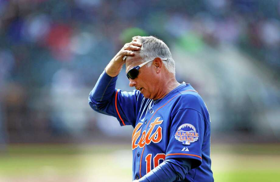New York Mets manger Terry Collins walks off the field after getting ejected in the 10th inning of the baseball game against the Atlanta Braves at Citi Field Wednesday, Aug. 21, 2013 in New York. The Braves beat the Mets 4-1. (AP Photo/Seth Wenig) Photo: AP / AP