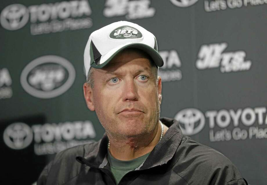 New York Jets head coach Rex Ryan talks to reporters after a practice in Florham Park, N.J., Monday, Aug. 19, 2013. (AP Photo/Seth Wenig) Photo: AP / AP