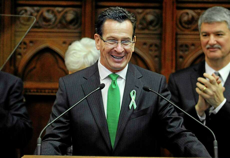 Connecticut Gov. Dannel P. Malloy delivers his State of the State address to the House and the Senate at the Capitol in Hartford, Conn., Wednesday, Jan. 9, 2013. Gun control, mental health care and school safety are expected to be major topics in the new session. Legislators also must grapple with a projected deficit of about $1.2 billion. (AP Photo/Jessica Hill) Photo: AP / FR125654 AP