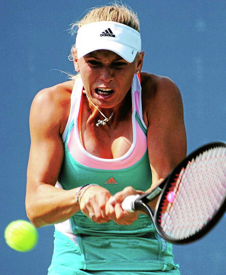 Caroline Wozniacki hits a backhand return to Karin Knapp  in their singles match Wednesday. Open Tuesday, Aug. 21, 2013. Photo: BOB CHILD — For The Register