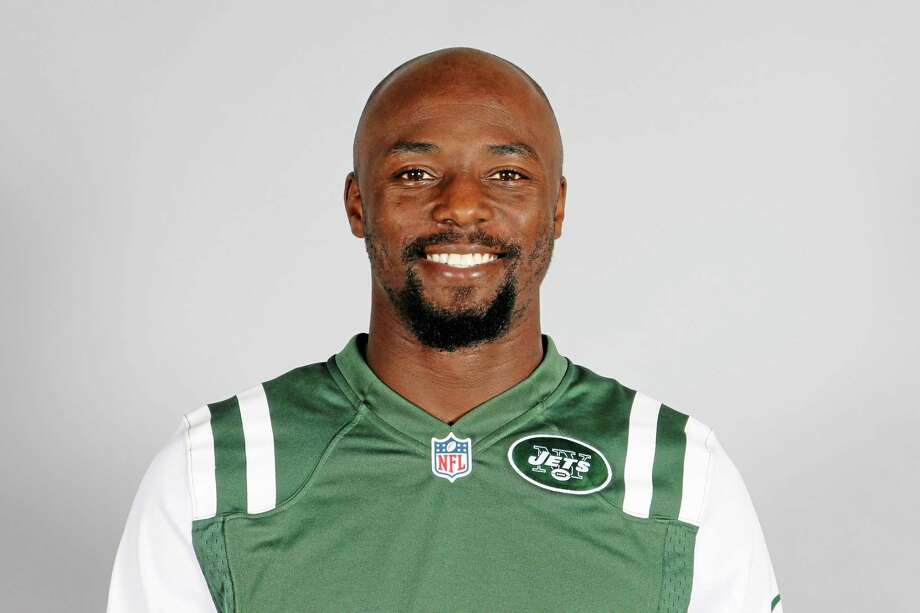 "File-This  June 10, 2013 file photo shows Santonio Holmes of the New York Jets NFL football team. Holmes is on the physically unable to perform list while he rehabilitates a left foot injury that has sidelined him since early last season. He has been doing some light jogging and riding a stationary bike during practice. He also used an anti-gravity treadmill to reduce pressure on the foot, but has not been able to get past one major hurdle just yet. ""Right now, I can't run,"" Holmes said. (AP Photo) Photo: AP / NFLPV AP"