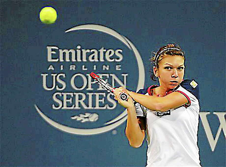 Simona Halep, from Romania, watches a return to Samantha Stousr, from Australia, at the Western & Southern Open tennis tournament, Thursday, Aug. 15, 2013, in Mason, Ohio. (AP Photo/Michael E. Keating) Photo: AP / FR170759 AP