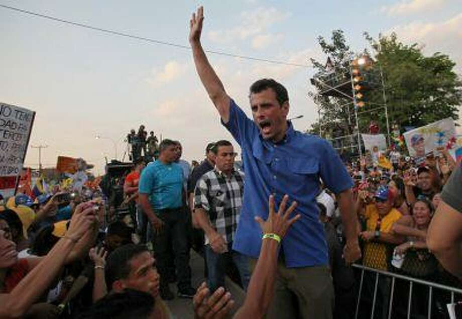 Opposition presidential candidate Henrique Capriles greets supporters during a campaign rally in Puerto La Cruz, Venezuela, April 8. Capriles is running against ruling party candidate Nicolas Maduro in next weekend's presidential election. Photo: ASSOCIATED PRESS / AP2013