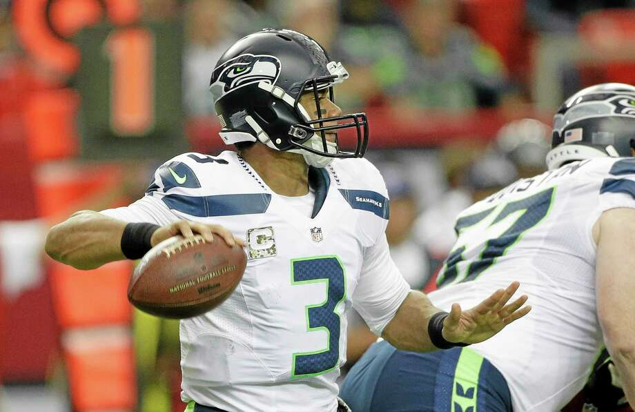 Dan Nowak believes Russell Wilson and the Seahawks will blow out the Vikings Sunday in Seattle. Photo: John Bazemore — The Associated Press  / AP