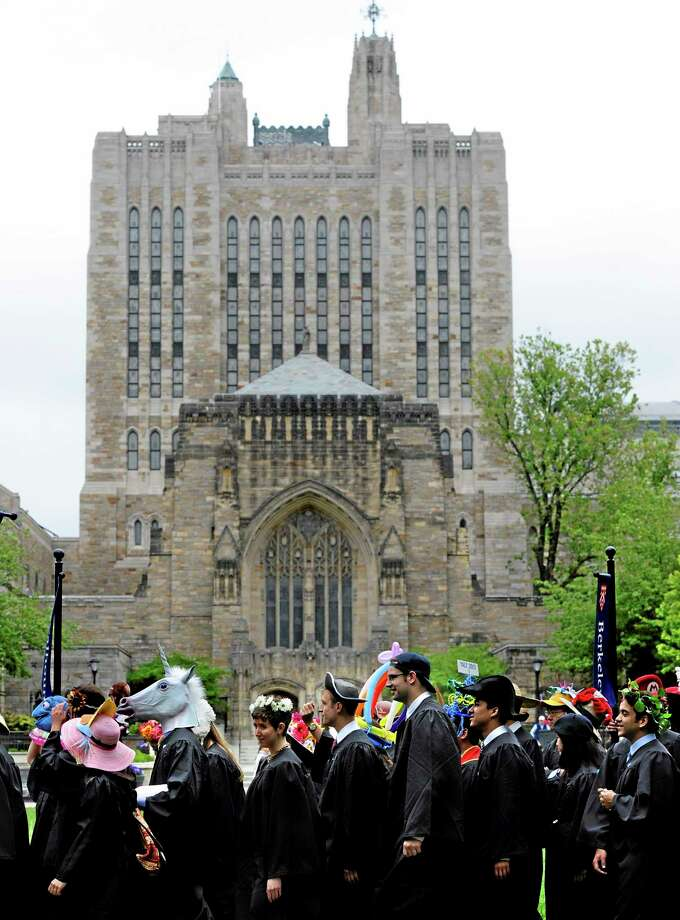 Students wearing decorative hats line up for the procession during Class Day for Yale seniors at Yale University in New Haven, Conn., Sunday, May 19, 2013. (AP Photo/Jessica Hill) Photo: AP / FR125654 AP