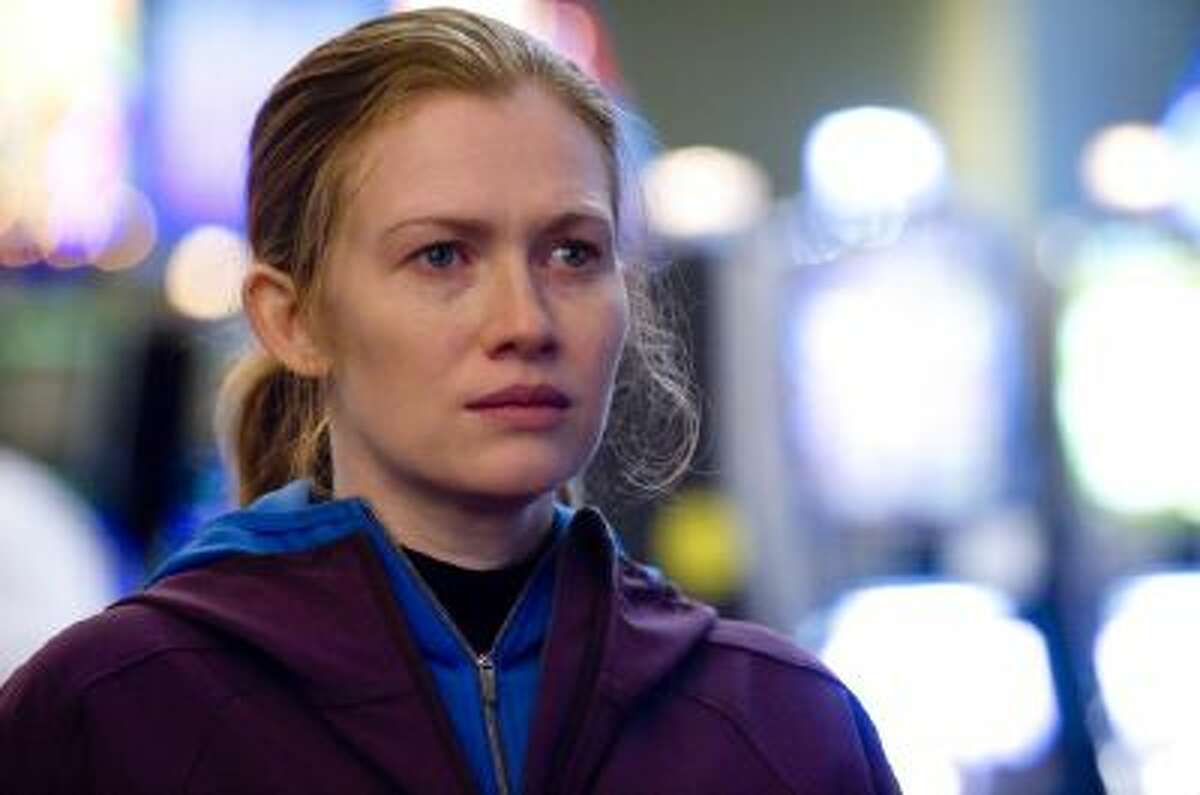 In this publicity image released by AMC, Mireille Enos is shown in a scene from