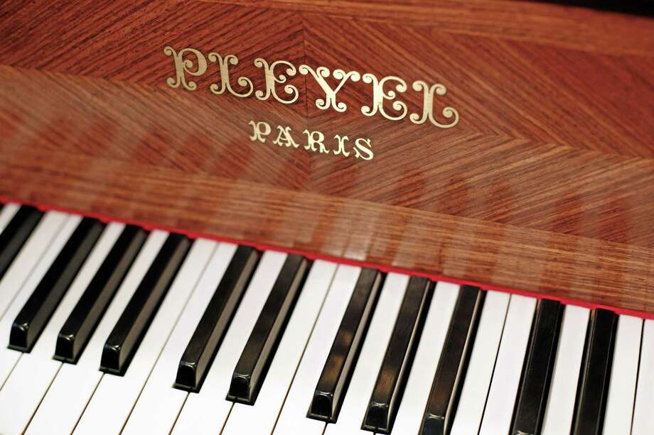A Pleyel piano is exhibited in a display of instruments in Paris on Saturday. The French factory announced it will close because of costs and decreased demand after 206 years in business. (AP Photo/Thibault Camus) Photo: AP / AP