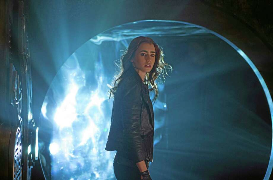 """This film publicity image released by Screen Gems shows Lilly Collins as Clary in a scene from """"The Mortal Instruments: City of Bones."""" (AP Photo/Sony Pictures Screen Gems, Rafy) Photo: AP / Sony Pictures Screen Gems"""