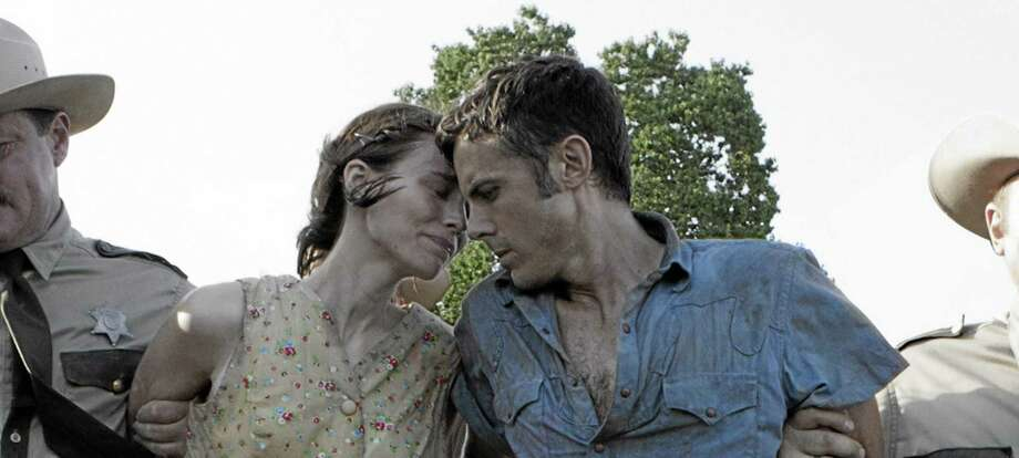 """This film image released by IFC Films shows Rooney Mara, left, and Casey Affleck in a scene from """"Ain't Them Bodies Saints."""" (AP Photo/IFC Films) Photo: AP / IFC Films"""
