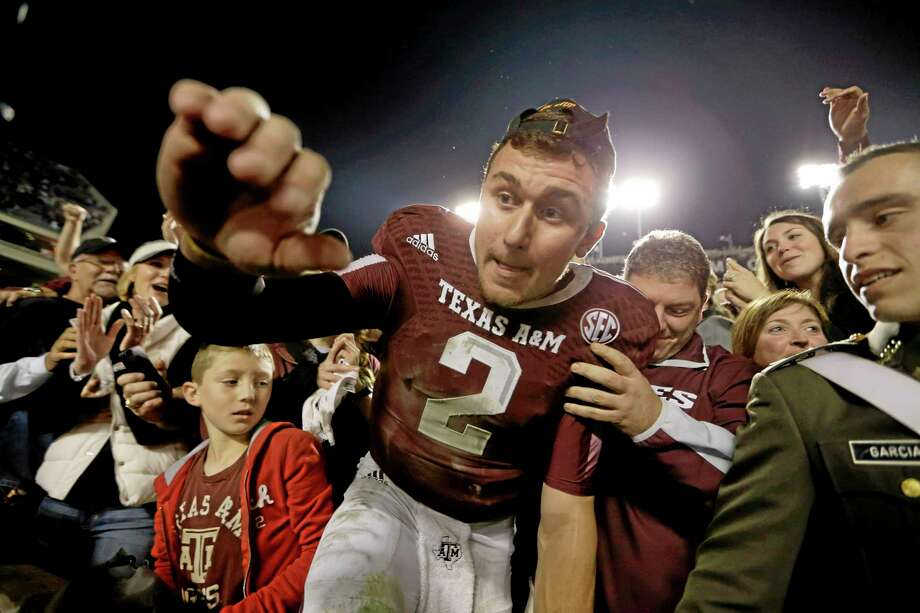 Texas A&M quarterback Johnny Manziel is one of the 15 players to watch for the Walter Camp Football Foundation Player of the Year Award. Photo: David J. Phillip — The Associated Press  / AP