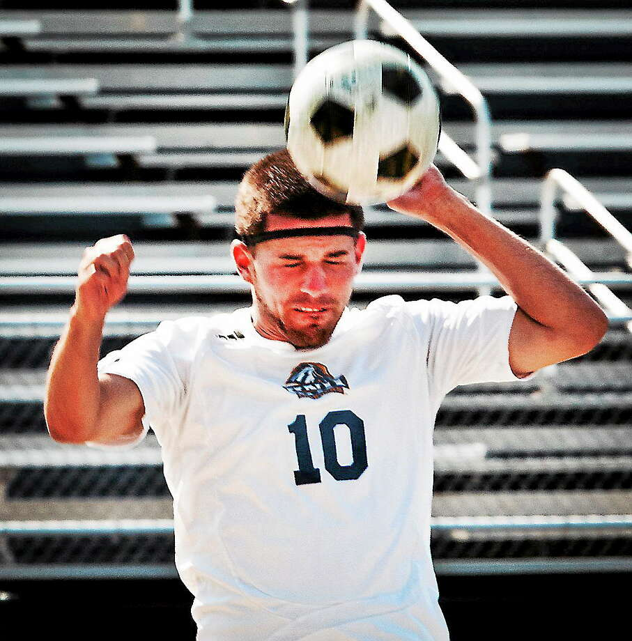 Melanie Stengel — Register       University of New Haven soccer player, Andres Torres, heads the ball while wearing the new impact sensor from Triax Technologies. 08/20. UNH will be the first college in the nation to use the high tech devices to monitor head trauma to its student athletes. Photo: Journal Register Co.