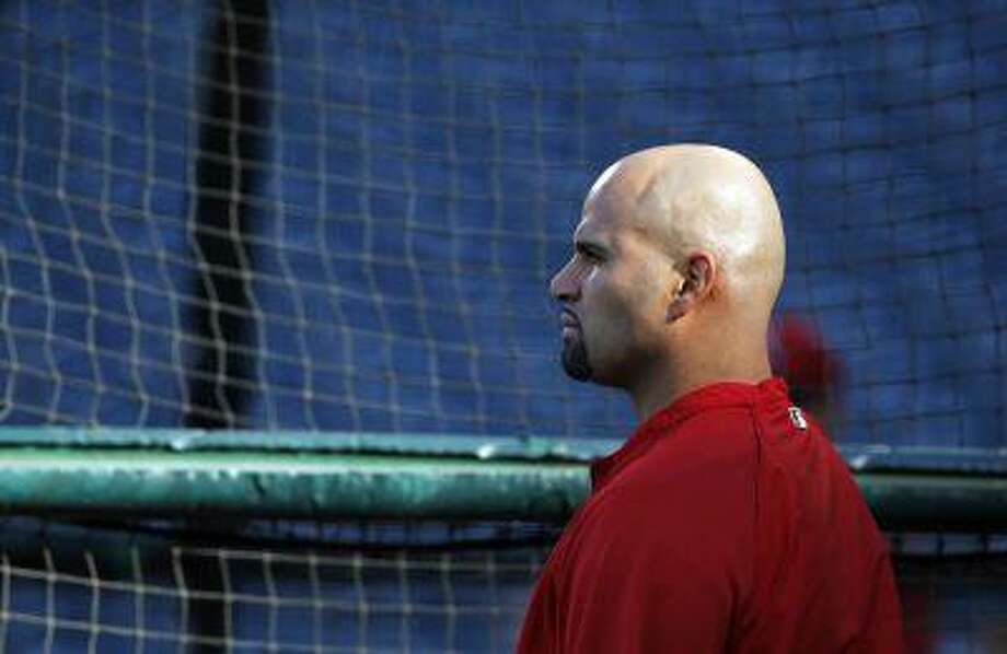File-This April 19, 2013 file photo shows Los Angeles Angels first baseman Albert Pujols at the batting cage in Anaheim. Pujols is done for the season because of an injured left foot. The Angels made the announcement Monday Aug. 19, 2013, before playing Cleveland. Pujols hasn't played since July 26. He had been saying he wanted to return when his partially torn plantar fascia healed. Photo: AP / FR170211 AP