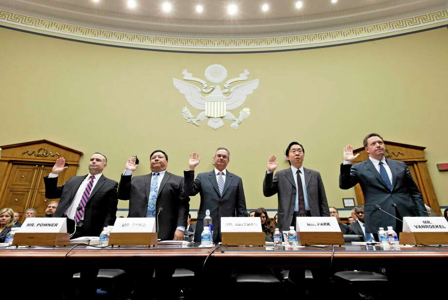 From left, David Powner, director of information technology management issues at the Government Accountability Office; Henry Chao, deputy chief information officer for Medicare and Medicaid Services; Frank Baitman, deputy assistant secretary for information technology at the Department of Health and Human Services; Todd Park, U.S. chief technology officer at the White House Office of Science and Technology Policy; and Steve VanRoekel, U.S. chief information officer at the Office of Electronic Government in the Office of Management and Budget, are sworn in to testify before the House Oversight Committee about problems implementing the Obamacare healthcare program, on Capitol Hill in Washington, Wednesday, Nov. 13, 2013.  (AP Photo/J. Scott Applewhite) Photo: AP / AP