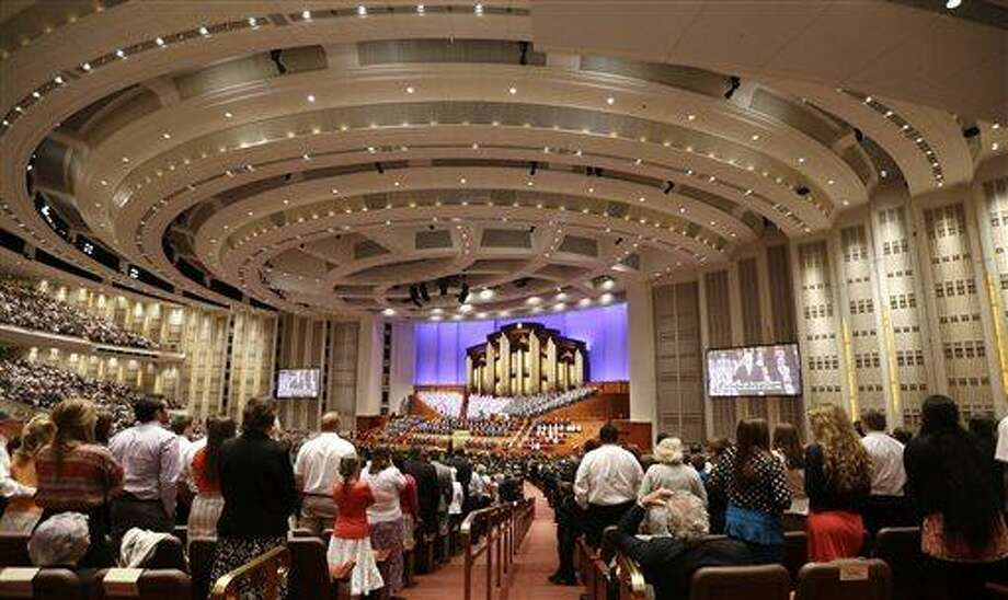 People gather inside the Conference Center during the 183rd Annual General Conference of The Church of Jesus Christ of Latter-day Saints Saturday, April 6, 2013, in Salt Lake City. The Mormon church is planning to build two new temples in Rio de Janeiro and Cedar City, Utah. The faith's president, Thomas S. Monson, announced the new temples on Saturday during the 183rd semi-annual general conference of The Church of Jesus Christ of Latter-day Saints. More than 100,000 members of the church have gathered in Salt Lake City to hear words of inspiration and guidance for daily living from the faith's senior leaders.  (AP Photo/Rick Bowmer) Photo: AP / AP