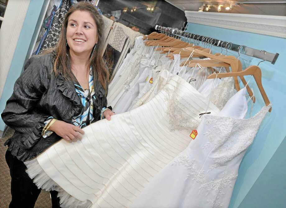 Shelley Bailey, of The Wedding Dress at 222 Main St. in Portland will donate dresses this weekend to brides in Haiti. Photo: Catherine Avalone - The Middletown Press   / TheMiddletownPress