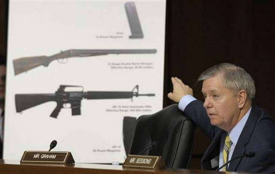 In this Jan. 30, 2013, photo Senate Judiciary Committee member Sen. Lindsey Graham, R-S.C., talks about gun legislation during the committee's hearing on Capitol Hill in Washington. Congress returns from a two-week spring recess Monday, April 8, 2013, with gun control and immigration high on the Senate's agenda. Senators could start debating Democratic-written gun legislation before week's end, but leaders may decide to give negotiators more time to seek a deal on expanding background checks for firearms buyers. The Associated Press file photo. Photo: AP / AP