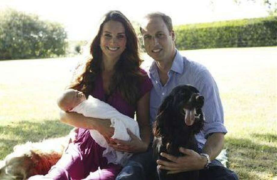 This image taken by Michael Middleton, the Duchess's father, in early August 2013 and supplied by Kensington Palace, shows the Duke and Duchess of Cambridge with their son, Prince George, in the garden of the Middleton family home in Bucklebury, England, with Tilly the retriever, seen left, a Middleton family pet, and Lupo, the couple's cocker spaniel. (AP Photo/Michael Middleton/TRH The Duke and Duchess of Cambridge ) EDITORIAL USE ONLY Photo: AP / TRH The Duke and Duchess of Camb