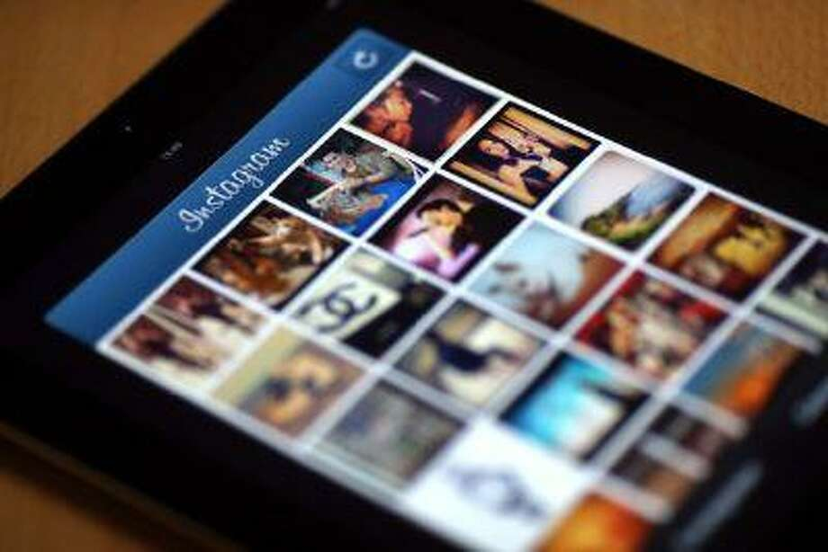 Instagram contests are the latest example of how technology is pervading the lives of children in ways that parents and teachers struggle to understand or monitor. (Thomas Coex/AFP/Getty Images)