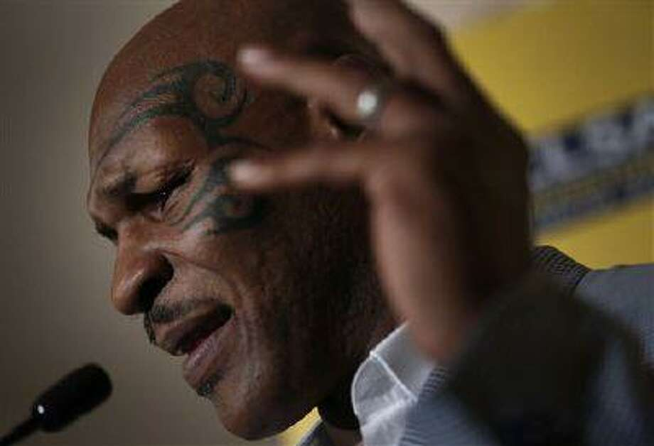 Former heavyweight boxing champion Mike Tyson speaks a press conference at the 19th Credit Lyonnais Securities Asia investors Forum at a hotel in Hong Kong Wednesday, Sept. 12, 2012. Photo: ASSOCIATED PRESS / AP2012