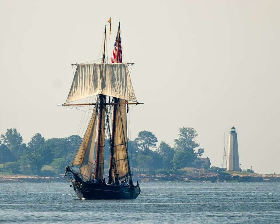 The Amistad makes its way into New Haven Harbor with the New Haven Lighthouse in the distance, a year to the day since it left for its tour around the world. Peter Casolino/Register