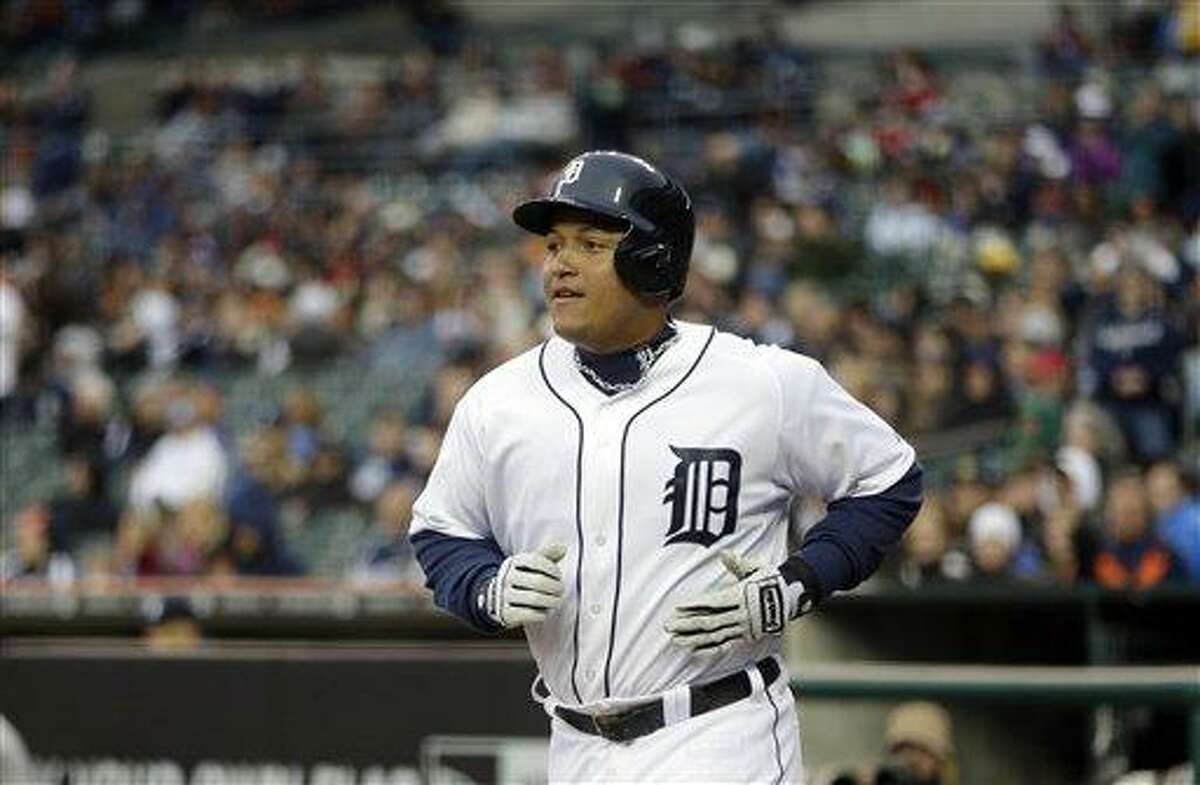 Detroit Tigers third baseman Miguel Cabrera walks back to the dugout after scoring in the eighth inning of a baseball game against the New York Yankees in Detroit, Saturday, April 6, 2013. (AP Photo/Carlos Osorio)