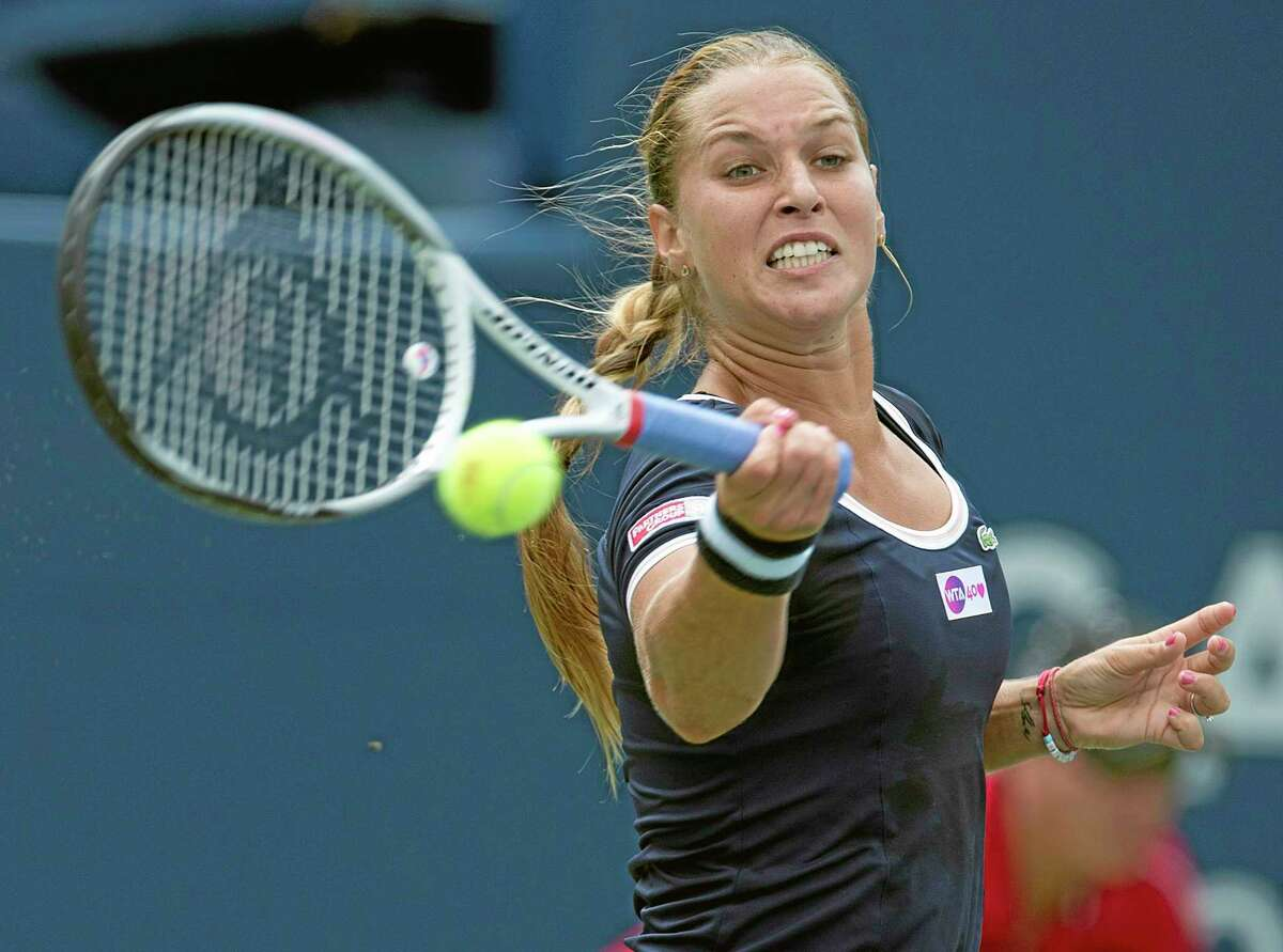 Dominika Cibulkova of Slovakia hits a forehand to Angelique Kerber of Germany during their Rogers Cup women's tennis match in Toronto on Tuesday, Aug. 6, 2013. (AP Photo/The Canadian Press, Frank Gunn)