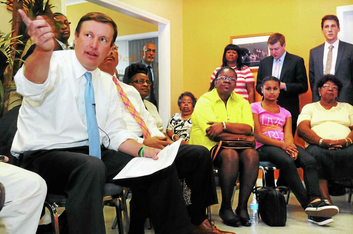 Mara Lavitt — Register August 19, 2013 New Haven, Dixwell Community Center. US Senator Chris Murphy held a roundtable discussion with members of the community, including Barbara Fair of My Brother's Keeper, third from right, about Justice Dept. policy changes regarding juvenile justice.
