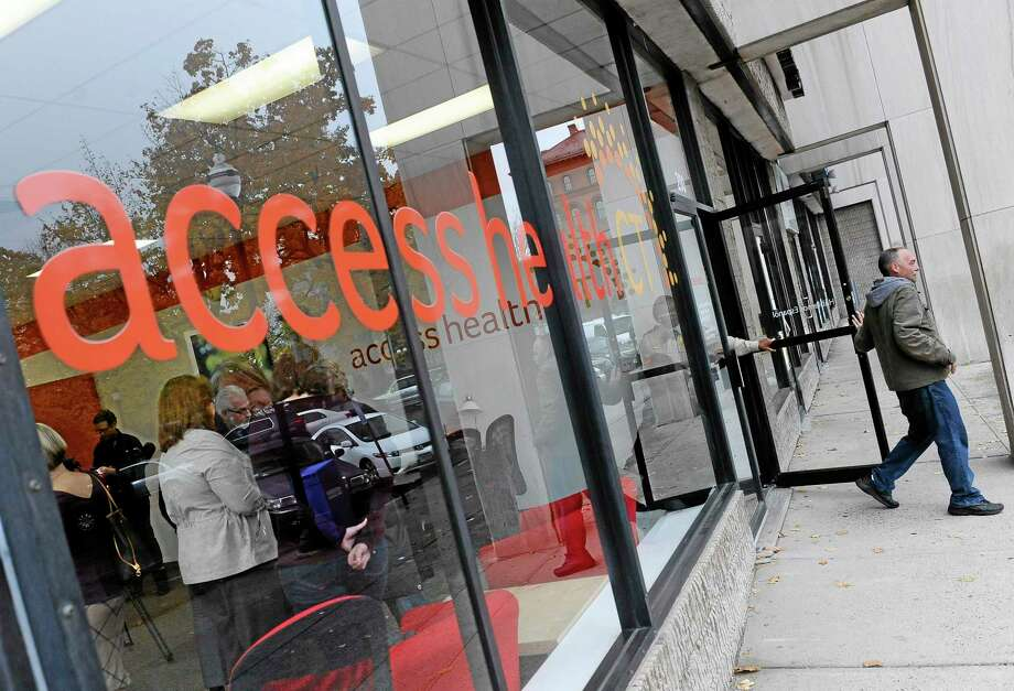 A man leaves Access Health CT, Connecticut's health insurance exchange's first insurance store, Thursday, Nov. 7, 2013, in New Britain, Conn.  The site, where people can visit to sign up for coverage, is the first in the nation. (AP Photo/Jessica Hill) Photo: AP / FR125654 AP