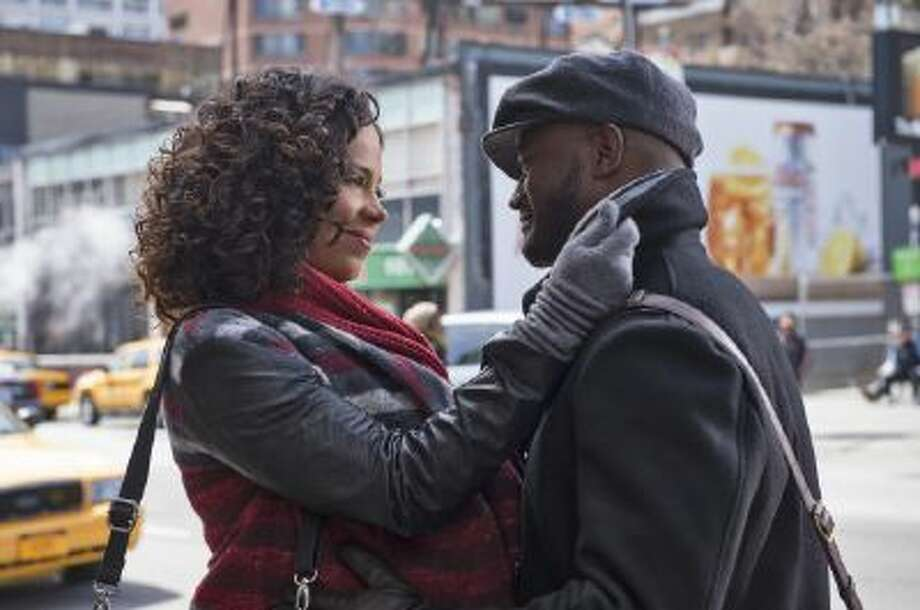 Still of Taye Diggs and Sanaa Lathan in The Best Man Holiday.