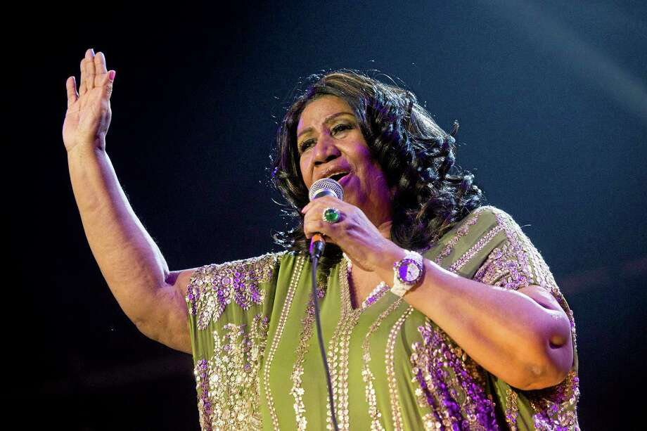 """FILE - In this May 11, 2013 file photo, Aretha Franklin performs during McDonald's Gospelfest 2013 at the Prudential Center in Newark, N.J.Franklin won't say what has caused her latest health problems, but says she's had a """"miraculous"""" recovery and is looking forward to performing soon.In a phone interview on Tuesday, Aug. 20,  Franklin said that she recently had a cat scan and that it showed she was 85 percent improved. The 71-year-old has canceled several concerts and public appearances and blamed it on unspecified treatment.   (Photo by Charles Sykes/Invision/AP, File) Photo: Charles Sykes/Invision/AP / Invision"""