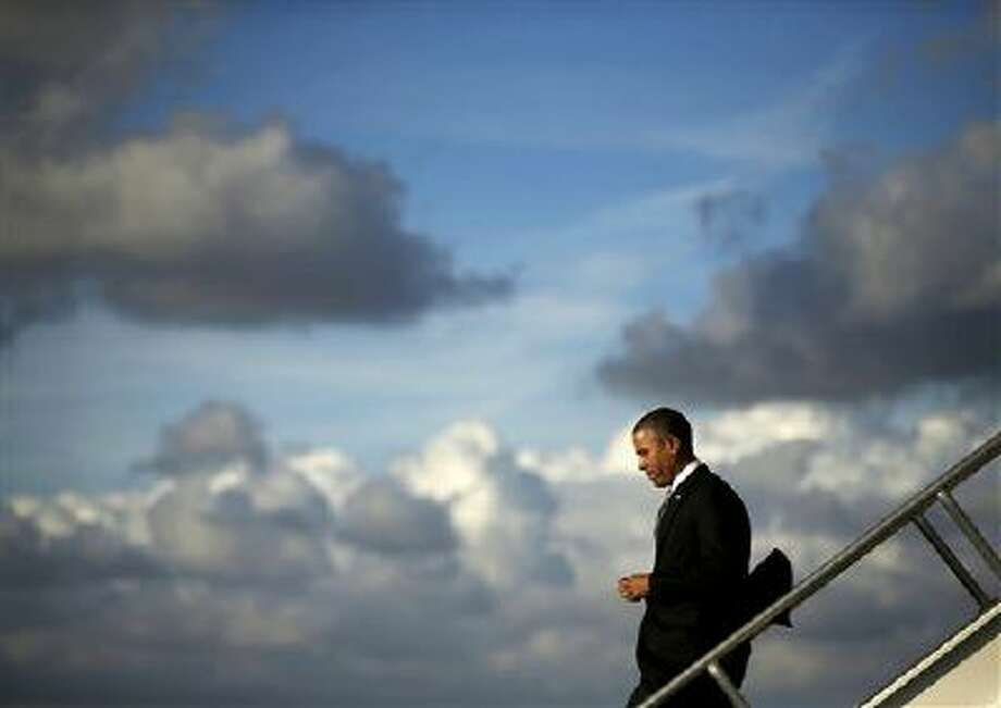 President Barack Obama steps off Air Force One upon his arrival Nov. 8 at Miami International Airport. Obama traveled to the south Florida area for three Democratic fundraisers. Photo: AP / AP