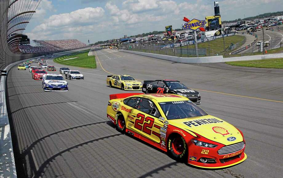 Joey Logano leads the field during the Pure Michigan 400 at Michigan International Speedway on Sunday. Photo: Paul Sancya — The Associated Press  / AP