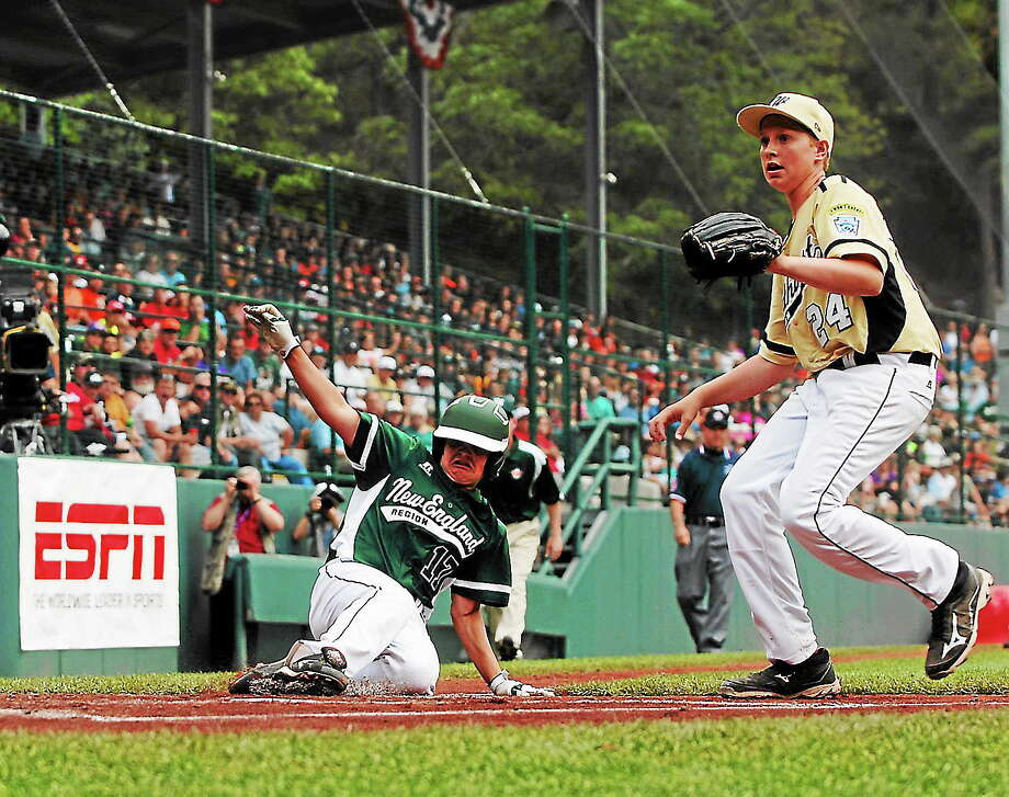 Westport's Charlie Roof slides safely into home in the second inning against Eastlake at the Little League World Series on Sunday. Photo: Mary Albl — Register