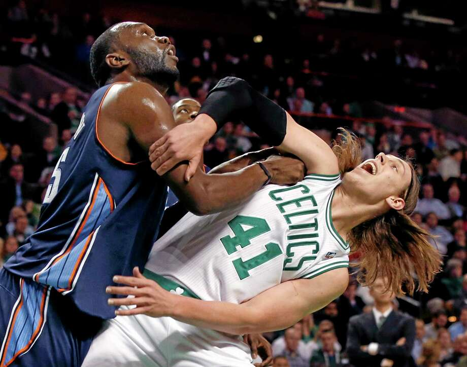 Al Jefferson and the Charlotte Bobcats outmuscled Kelly Olynyk and the Celtics on Wednesday night in Boston. Photo: Elise Amendola — The Associated Press  / AP