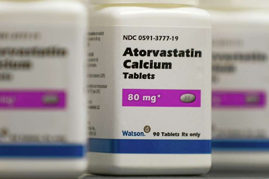 FILE - This undated photo provided by by Watson Pharmaceuticals Inc., shows Atorvastatin Calcium tablets, a generic form of Lipitor, which is being sold under a deal with Pfizer. The nation's first new guidelines in a decade for preventing heart attacks and strokes call for twice as many Americans — one-third of all adults — to consider taking cholesterol-lowering statin drugs such as this or Zocor or Crestor. The guidelines, issued Tuesday, Nov. 12, 2013 by the American Heart Association and American College of Cardiology, are a big change. They use a new formula for estimating someone's risk that includes many factors besides cholesterol, the main focus now. (AP Photo/Watson Pharmaceuticals Inc., Bill Gallery) Photo: AP / Watson Pharmaceuticals Inc.