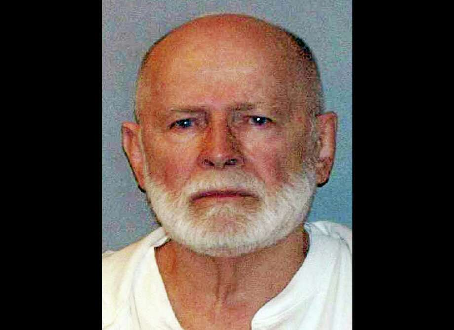 "FILE - This June 23, 2011 booking file photo provided by the U.S. Marshals Service shows gangster  James ""Whitey"" Bulger. Federal prosecutors argued Thursday, Nov. 7, 2013 that Bulger ""deserves no mercy"" and asked a judge to sentence him to two consecutive life sentences, plus five years, in a string of murders and extortions. Bulger, the 84-year-old former leader of the notorious Winter Hill Gang, was convicted in August after spending more than 16 years on the run. (AP Photo/ U.S. Marshals Service, File) Photo: AP / U.S. Marshals Service/ US Department of Justice"