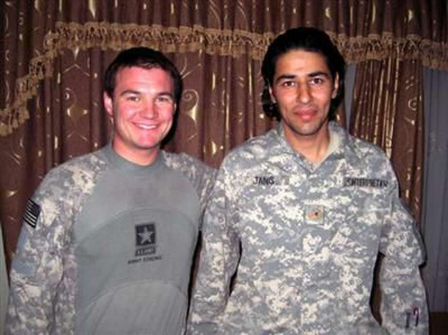 Matt Zeller, left, poses for a photo with Janis Shinwari. Shinwari, who served as an Afghan interpreter with U.S. forces for seven years, recently arrived in the United States with his family. Zeller credits Shinwari with saving his life during a battle in Afghanistan.