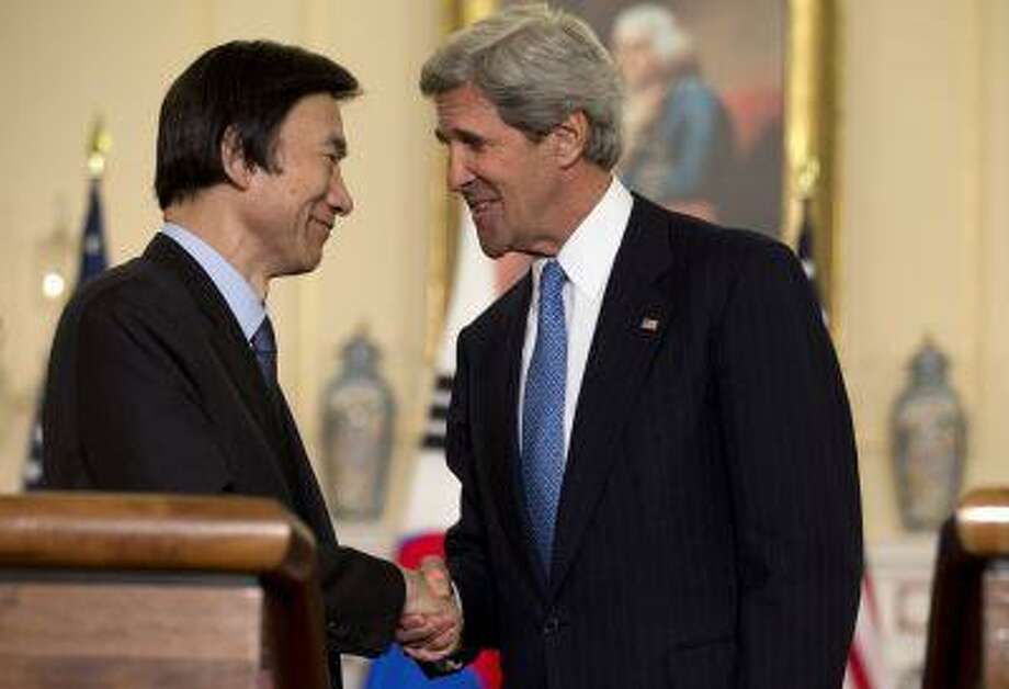 U.S. Secretary of State John Kerry, right, shakes hands with South Korean Foreign Minister Yun Byung-Se, at the State Department in Washington, on Tuesday, April 2, 2013. (AP Photo/Jacquelyn Martin) Photo: AP / AP