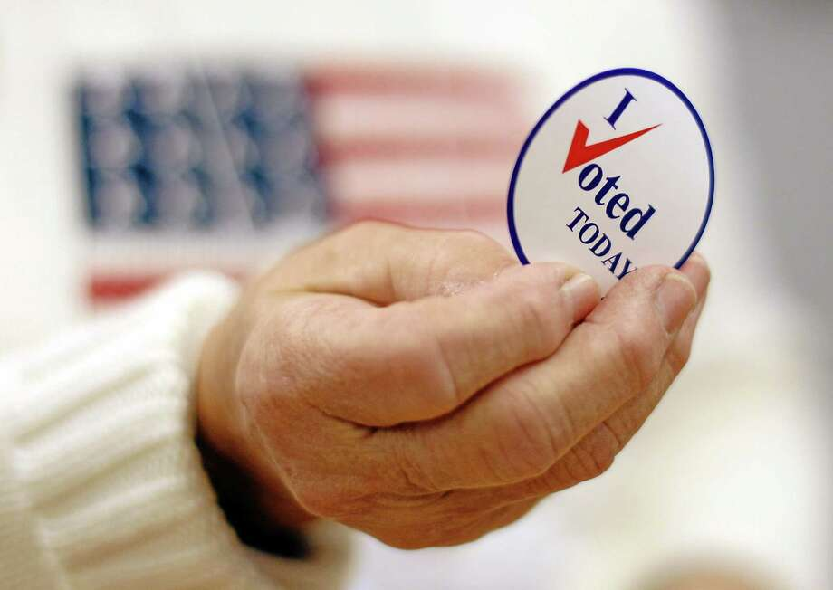 This Nov. 2, 2010, file photo shows a sticker handed out to a voter on Election Day. Photo: AP File Photo  / AP