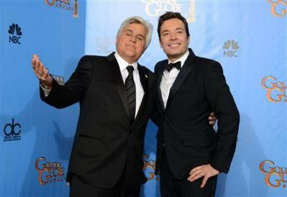 """This Jan. 13, 2013 file photo shows Jay Leno, host of """"The Tonight Show with Jay Leno,"""" left, and Jimmy Fallon, host of """"Late Night with Jimmy Fallon"""" backstage at the 70th Annual Golden Globe Awards in Beverly Hills, Calif. NBC announced Wednesday, April 3, 2013 that Jimmy Fallon is replacing Jay Leno as the host of """"The Tonight Show"""" in spring 2014. (Photo by Jordan Strauss/Invision/AP/file) Photo: Jordan Strauss/Invision/AP / Invision"""