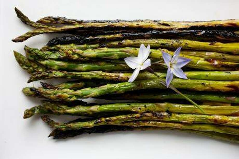 Blistered Asparagus. It doesn't get much more springlike than a grill, a bunch of asparagus and a light lemony dressing. Photo: The Washington Post / WASHINGTON POST