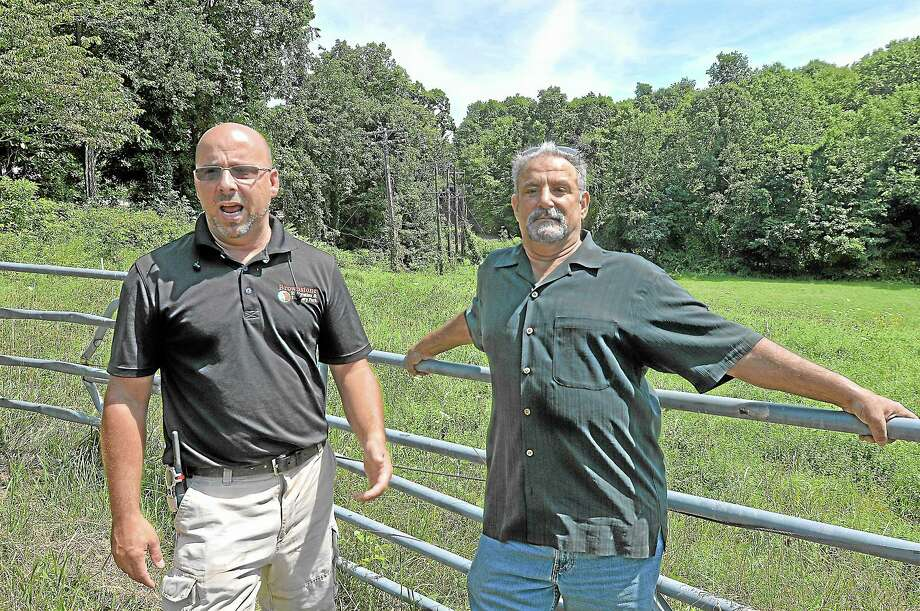 Sean Hayes, left, owner of Powder Ridge Mountain Park & Resort in Middlefield, and investor John Gramegna are frustrated with the lack of cooperation from CL&P and AT&T for the past nine months as contractors continue to work with generators. Catherine Avalone — The Middletown Press Photo: Journal Register Co. / TheMiddletownPress