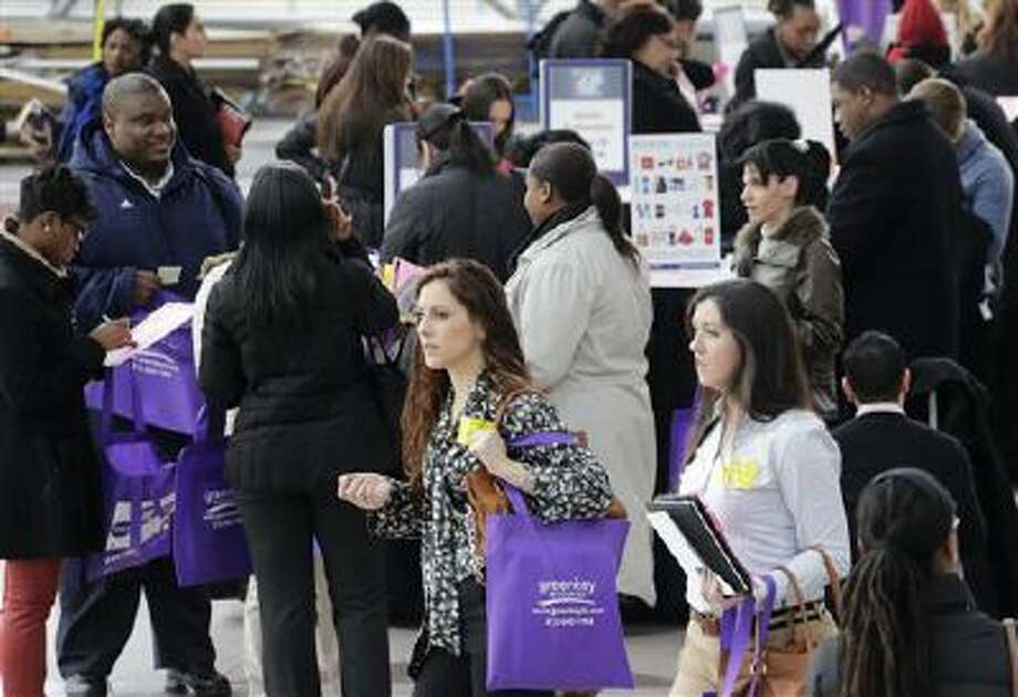 In this March 14, 2013, file photo, a crowd of job seekers attends a health care job fair in New York. Almost 6 million young people, ages 16 to 24, are neither in school nor working, according to a study released Monday, Oct. 21, 2013, by The Opportunity Nation coalition. Photo: ASSOCIATED PRESS / A2013